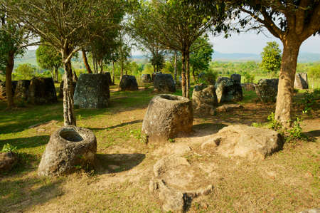 Ancient stone jars in a Plain of Jars (Site #3) near Phonsavan,  Xienghouang province, Laos. 写真素材