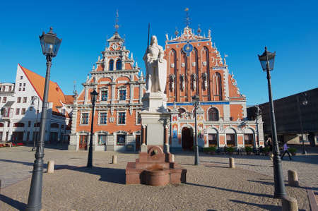 Riga, Latvia - August 03, 2009: City Hall square with House of the Blackheads, Roland statue and Saint Peter church in the old town in Riga, Latvia.