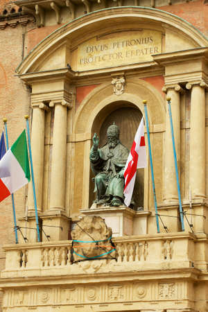 Bologna, Italy - May 11, 2013: Pope Gregory XIII statue bronze statue (by Alessandro Menganti) in front of Palazzo Comunale in Bologna, Italy. Publikacyjne