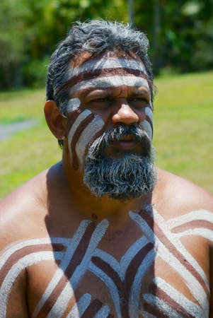 Kuranda, Australia - November 07, 2007: Portrait of aborigine actor with traditional face and body makeup in Tjapukai Culture Park in Kuranda, Queensland, Australia.