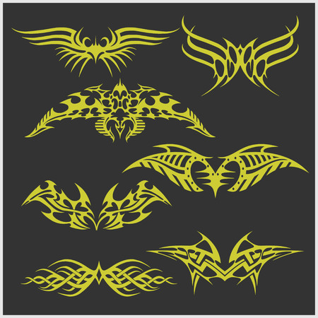 Symmetric tattoo set in tribal style on dark background