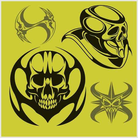 decrepit: Set of tribal skulls for tattoo. Isolated on green. Illustration
