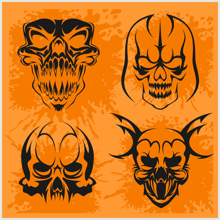 decrepit: Set of tribal skulls for tattoo. Isolated on dark.