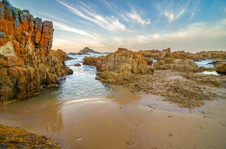 Knysna Heads Coast Landscape Rocks, Indian Ocean Waves Throght The Rocks At  Sunset, Garden