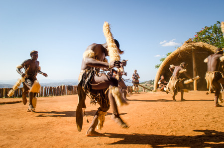 Zulu cultural experience, dressed in traditional gearZulu dressed in traditional gear dancing. Valley of a Thousand Hills, South Africa