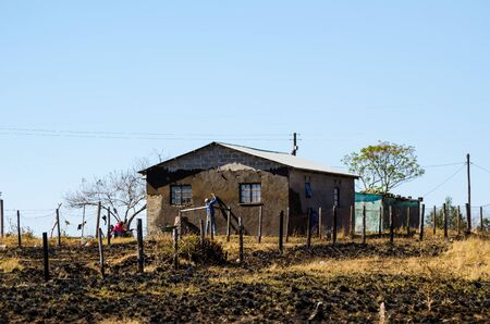 Man working building mud house, South africa, apartheid, zululand KwaZulu Natal