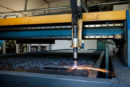Plasma cutting machine, flame with sparks, metal processing, metalwork industry