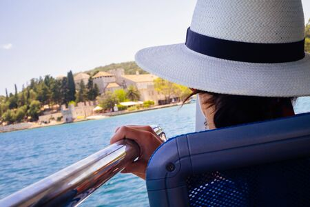Woman on a boat towards Saint Mary's Island. Mljet National Park, Mljet island, Dalmatia, Croatia.