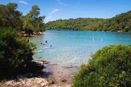 People in the small lake of a Mljet National Park, Mljet island, Dalmatia, Croatia. Outdoor activities. Travel destination.