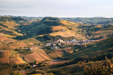 Barolo village, view from above. Langhe hilly landscape of vineyards in autumn. Viticulture of Dolcetto, Nebbiolo and Barbera red wine. Tourism in Europe, travel destination. Piedmont, Italy landmark.