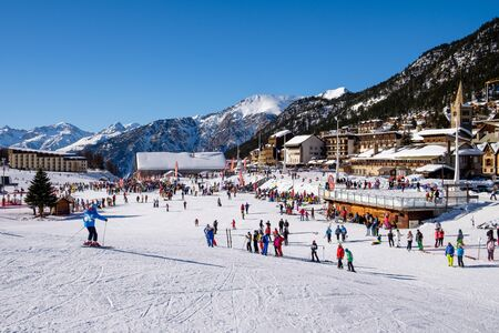 Montgenevre ski resorts with skier, village view. Winter sports in white week. Holidays destination France