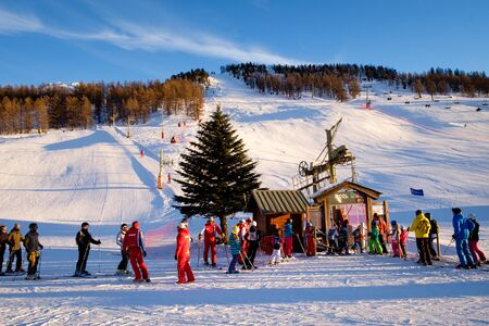 Montgenevre ski resort, people waiting in line for the ski lift. Winter holidays in France Redactioneel