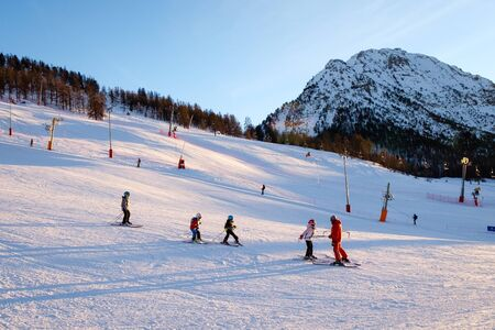 Montgenevre ski resort. Children taking ski lessons. Winter sports holiday destination France Redactioneel