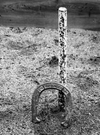 Horseshoe leaning against the post Stok Fotoğraf