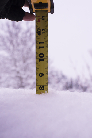 A ruler inserted into the snow to show the depth accumulated.