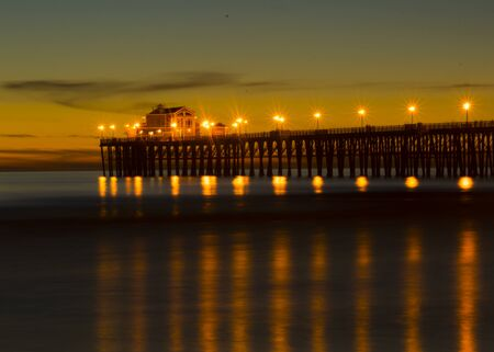 Sunset at Oceanside California pier showing the resturant at the end of the pier. Stock Photo