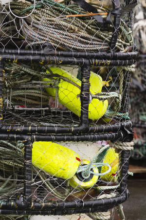 Crab pots stacked. Gear stored inside of pot.