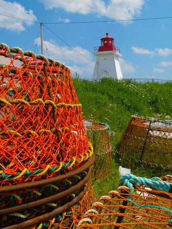 lighthouse and lobster pots photo