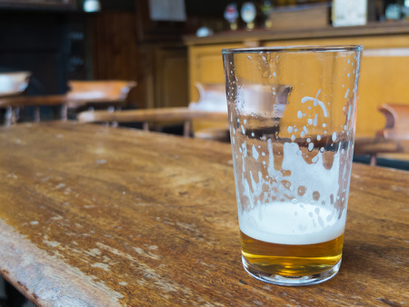 real ale: beer glass on bar table Stock Photo