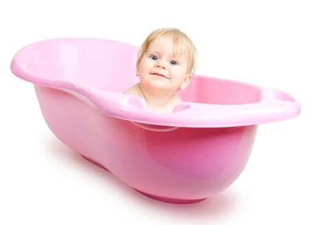 Baby girl bathing in the bath isolated on white