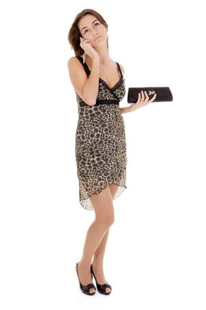 young woman in a dress for cocktails with a mobile phone