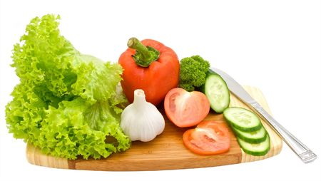 aftertaste: Salad and vegetables on a chopping board isolated on white