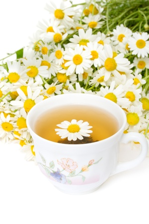 Herbal chamomile tea on a white background Stock Photo - 9824343