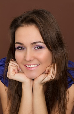 flying hair: Beautiful Smiling Woman. Amazing Brunette with flying hair