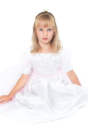 Portrait of a girl in a dress for first communion photo