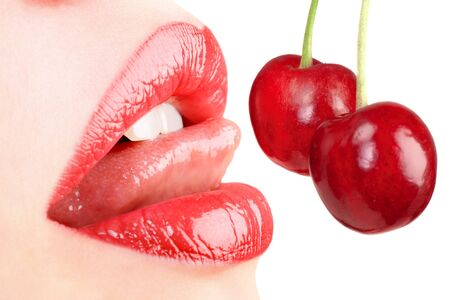 sensual lips with a cherry isolated on white Stock Photo