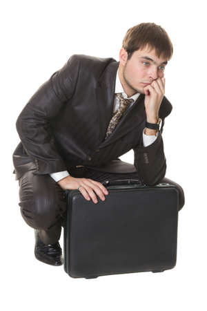 young businessman with briefcase thinking about their problems is isolated on a white Stock Photo - 9824392