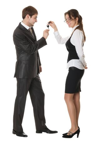 female manager gives a man a car key isolated on white photo