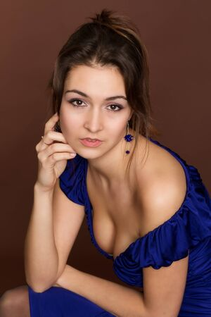 evening gown: Beautiful Young Woman. Amazing Brunette in evening gown Stock Photo