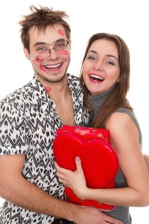zoenen: funny guy nerdy en glamoureuze meisje in een Valentine's Day Stockfoto