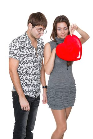 yoy: funny nerd guy gives a valentine glamorous girl isolated on white