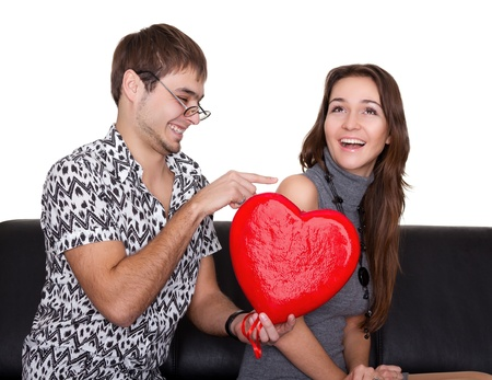 funny nerd guy gives a valentine glamorous girl isolated on white Stock Photo - 9826024