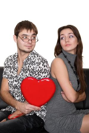 funny nerd guy gives a valentine glamorous girl isolated on white photo