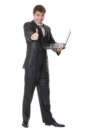 happy businessman holding a laptop and shows okay sign isolated on white photo