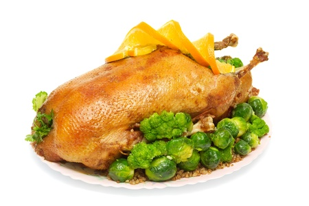 brussels sprouts: roast goose stuffed with buckwheat porridge, Brussels sprouts and broccoli isolated on white