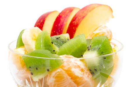 fresh fruit salad closeup isolated white