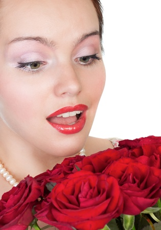 lovely woman with a bouquet of red roses photo