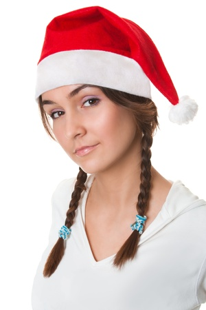 Christmas girl in santa hat isolated on white