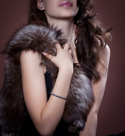 Woman in silver fox fur, focus on fur.  Fashion art photo. Stock Photo