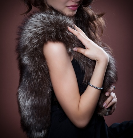 Woman in silver fox fur, focus on fur.  Fashion art photo. photo