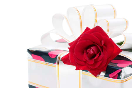 gift  decorated with ribbon and red rose isolated on white