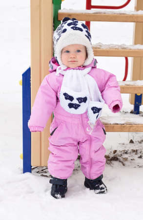 lovely baby girl for a walk on a winter day