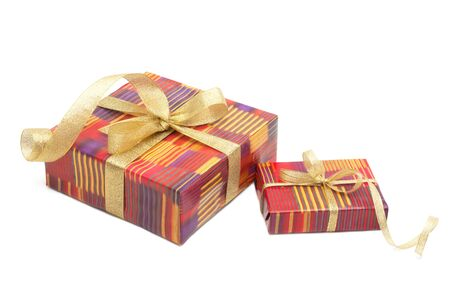 Holiday gift boxes decorated with ribbon isolated on white