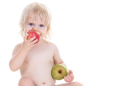 adorable baby girl with the apples isolated on white photo