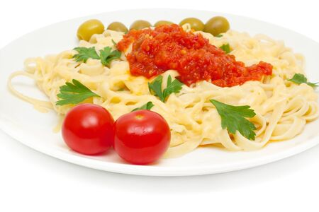 pasta with cheese and sauce of peppers, tomatoes and garlic isolated on white