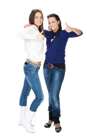 Two girls friends in jeans isolated on white